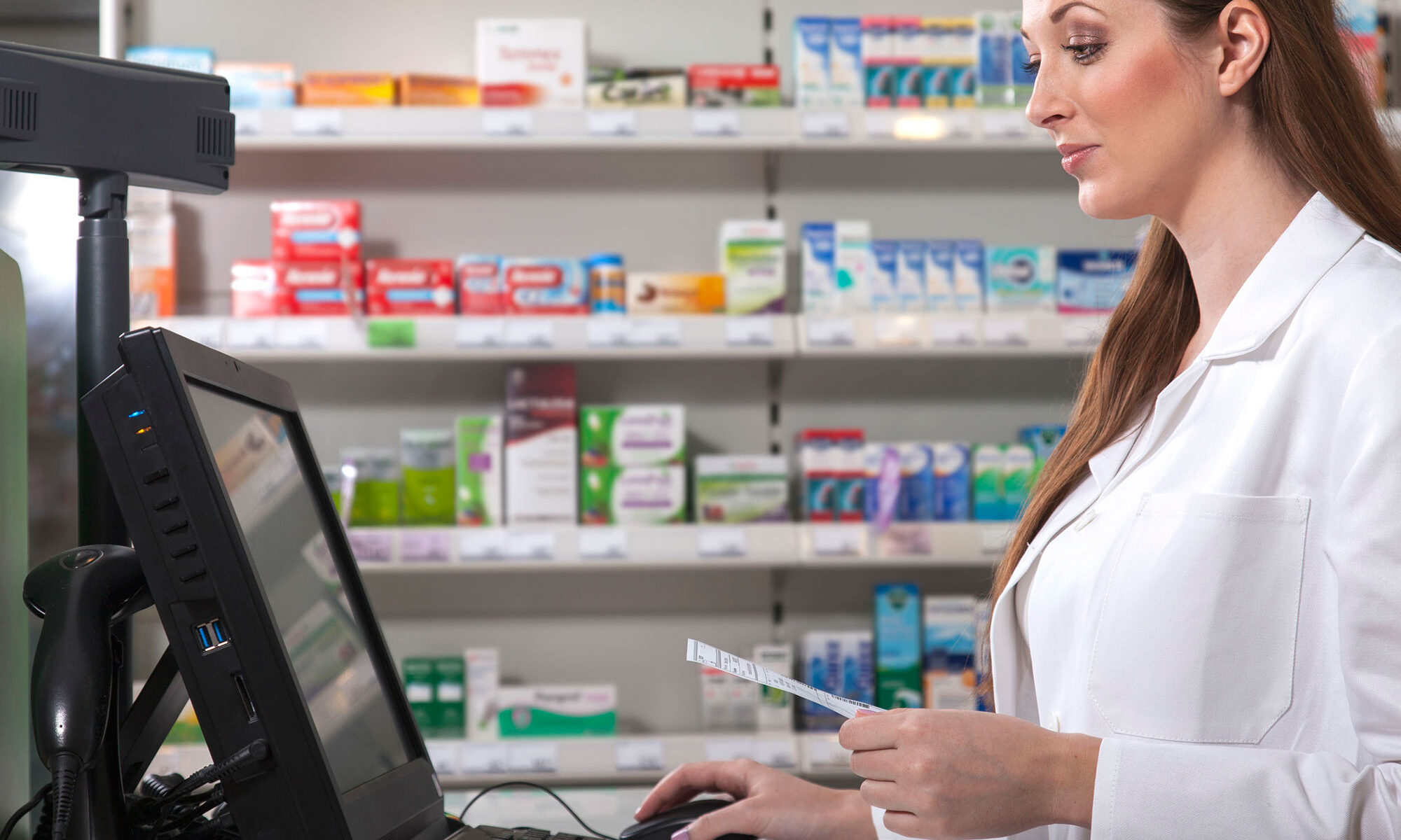 pharmacist with a prescription on the computer