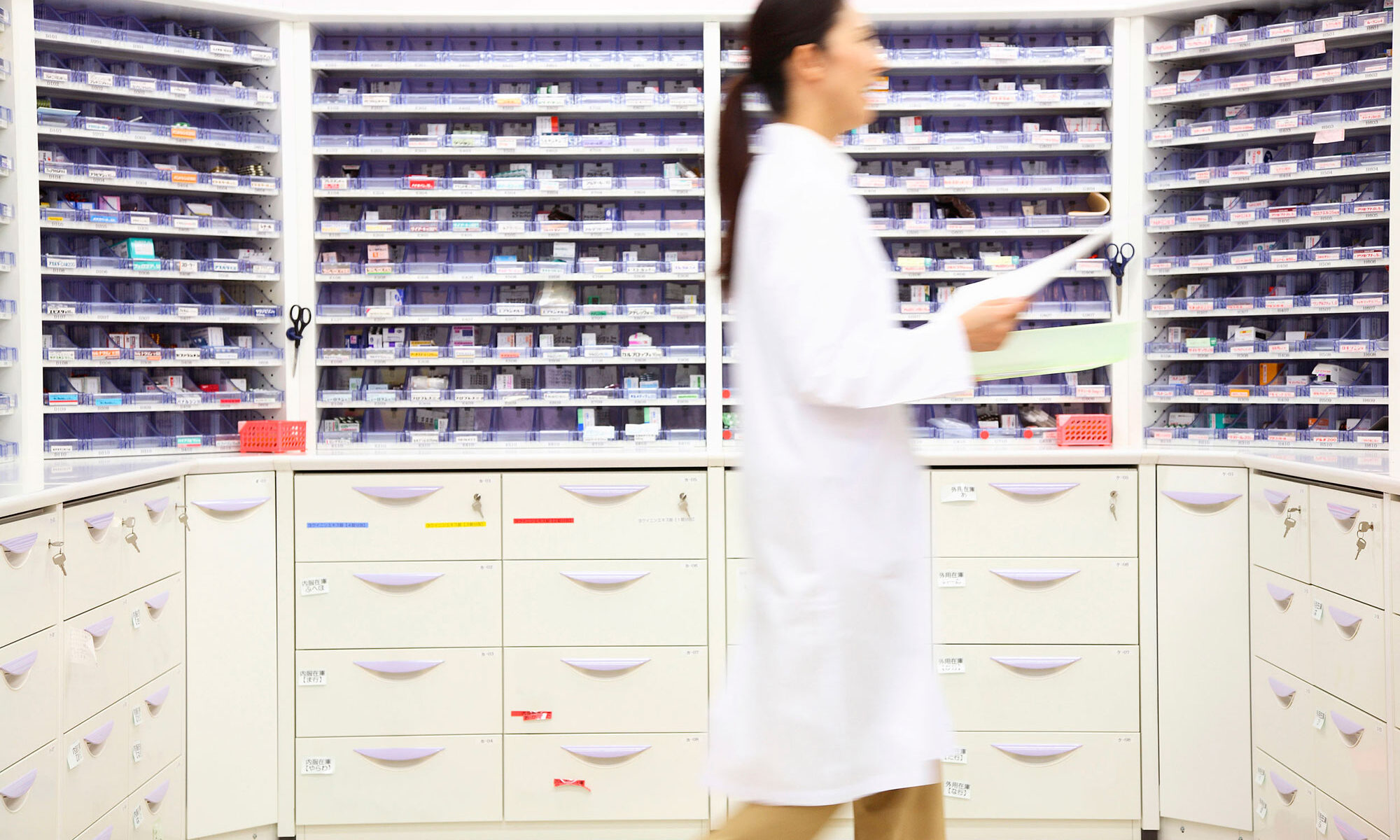 pharmacist filling out prescriptions for customers in Ashburton